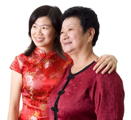 Asian Chinese Mother & Daughter looking away. photo
