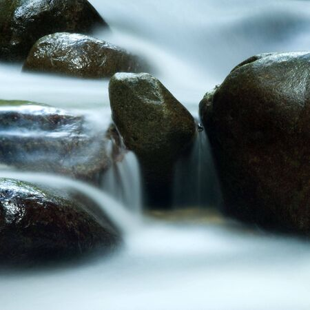 Zen water flowing in 25 seconds long exposure. photo