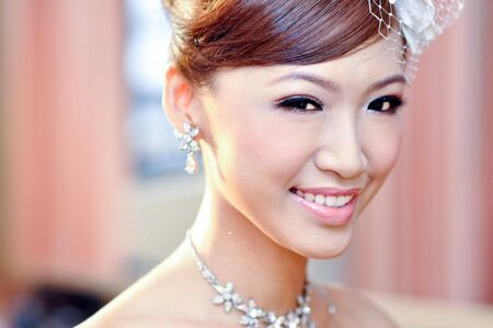 Beautiful young Asian bride smiling. photo