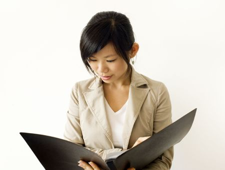 Asian girl reading document. For educationbusiness purpose. photo
