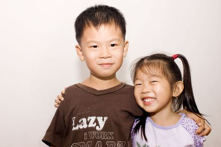 Big brother and little sister arms around each other. Stock Photo - 5290830