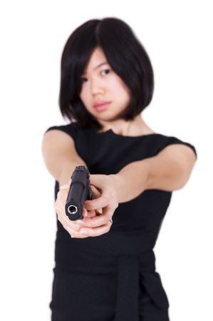 Beautiful Asian bodyguard woman holding a gun. Stock Photo - 5458843