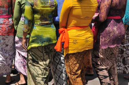 cultural and ethnic clothing: Rear view of Balinese women in traditional clothes. Stock Photo