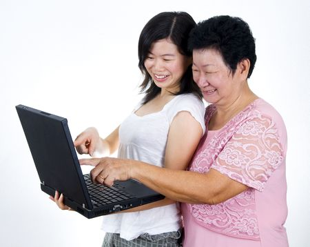 Senior mother and daughter sharing informations from internet. photo
