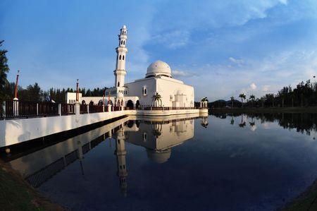 terengganu: Masjid Tengku Tengah Zaharah or also known as Floating Mosque in Kuala Terengganu, Malaysia with reflection.