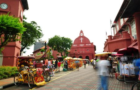 Tourist activity in front Christ Church. Christ Church is in the main square adjacent to Stadthuys, Melaka, Malaysia. photo