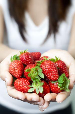Many fresh strawberries on hand. photo
