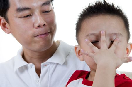 peek a boo: Portrait of Asian Chinese father and son.