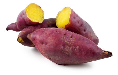 baked potato: Cooked whole and halved purple sweet potatoes.