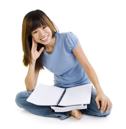 Asian student sitting on floor, blank book ready for text. photo