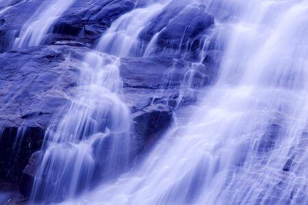 Waterfall in japanese garden, blue tone. photo