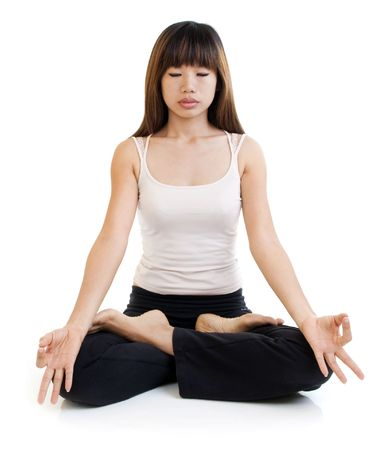 body posture: Young Asian woman having meditation with lotus position on white background. Stock Photo