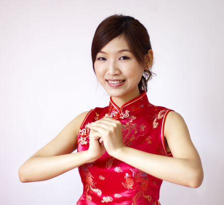 cheongsam: Oriental girl with traditional Cheongsam suit wishing you a happy Chinese New Year.