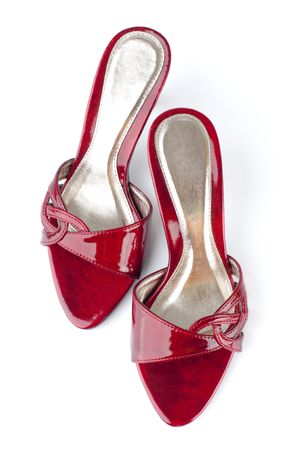 Pair of high heel red female shoes isolated on white background. photo