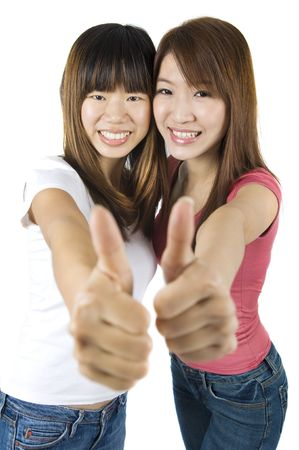 Young Asian University student giving thumbs up sign. photo