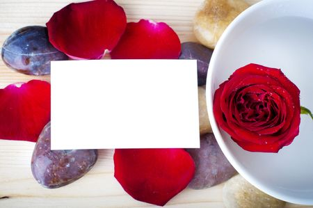 Rose, pebble and a blank card. photo