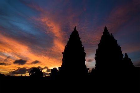 Dramatic sky with sun setting at Hindu temple Prambanan. Indonesia, Central Java, Yogyakarta Stock Photo - 6564501