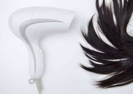 blow drier: Hair Dryer blowing on woman hair.
