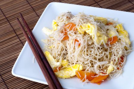 rice noodles: Asian fried rice vermicelli with eggs and carrot. Serve with chopsticks. Stock Photo