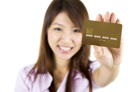 Asian woman holding a credit card, focus on the card. Card number and expiry date created by my own. photo