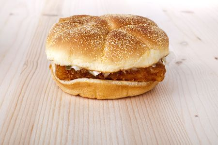 Fish burger on woodden dining table photo