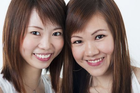 Close up cheerful Asian girls on white background photo