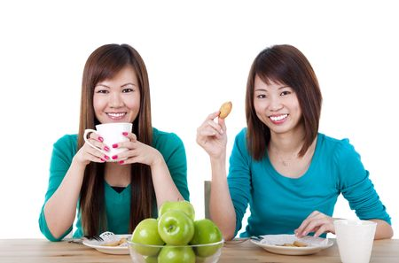 Two Asian women having tea break. photo