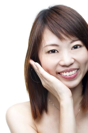Close up of smiling Asian woman on white background photo