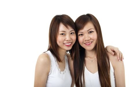 Two cheerful Asian girls isolated on white background. photo