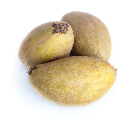 Tropical fruit - Chiku isolated on white background. photo