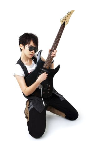 Punk Rockstar holding a guitar isolated in white photo