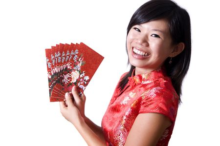 Happy oriental girl with cheongsam wishing you a happy Chinese New Year. photo