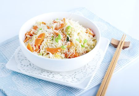 Asian fried rice noodles. Serve with chopsticks. photo
