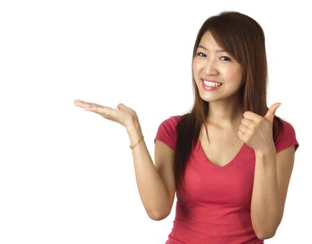 Close-up of a young Asian woman gesturing photo