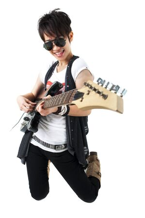 Punk Rockstar holding a guitar kneeling isolated in white photo