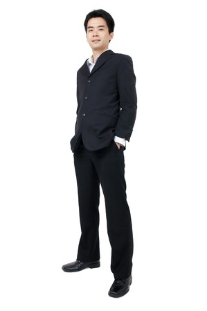 full suit: Full body of a smiling young Asian executive standing against isolated white background Stock Photo