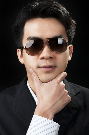 Portrait of a young man in suit and sunglasses. Stock Photo - 6903887