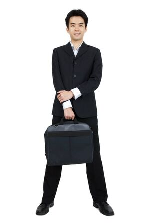 Full body of a smiling Asian businessman standing against isolated white background photo