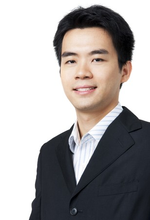 korean: Portrait of young Asian executive in black suit Stock Photo