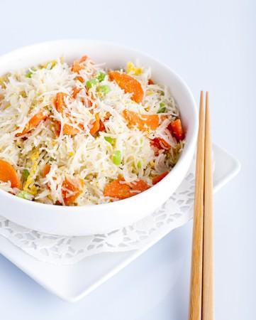Asian fried rice noodles. Serve with chopsticks. photo