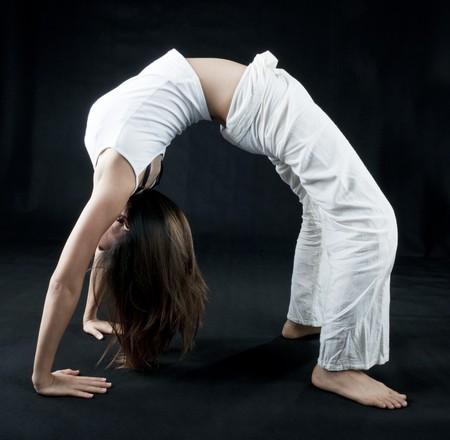 Female practising kung fu, on black background photo