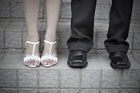 Bride and Groom standing on stairs photo