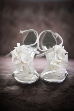 Soft-focus image of beautiful white bridal shoes. photo