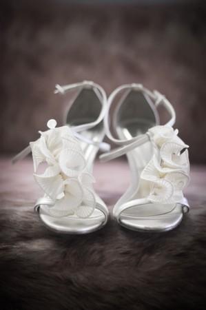 bridesmaid: Soft-focus image of beautiful white bridal shoes.