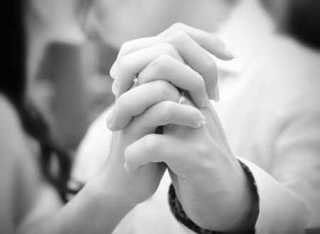 engagements: A bride and groom kissing on their wedding day, focus on hands
