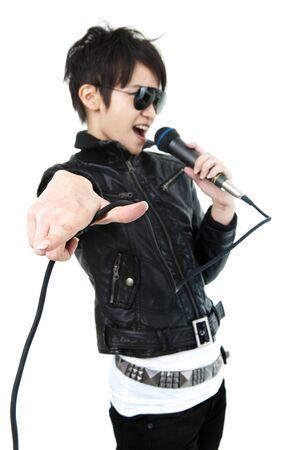 pop singer: Asian rock singer in performance, isolated on white, focus on fingers. Stock Photo