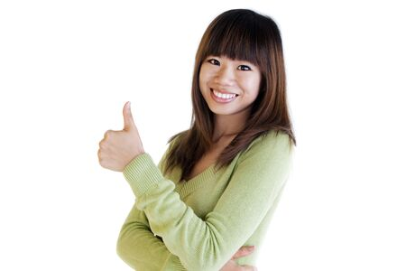 Young Asian female giving thumbs up sign. photo
