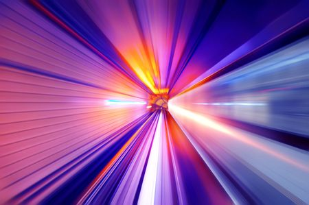 zoom: Fast train passing in a neon light tunnel Stock Photo