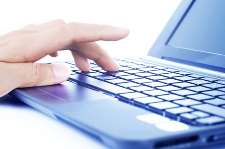 Closeup of a hand typing on laptop keyboard. Stock Photo - 7195387