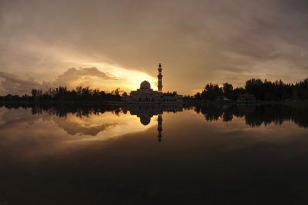 Masjid Tengku Tengah Zaharah or also known as Floating Mosque in Kuala Terengganu, Malaysia with reflection photo